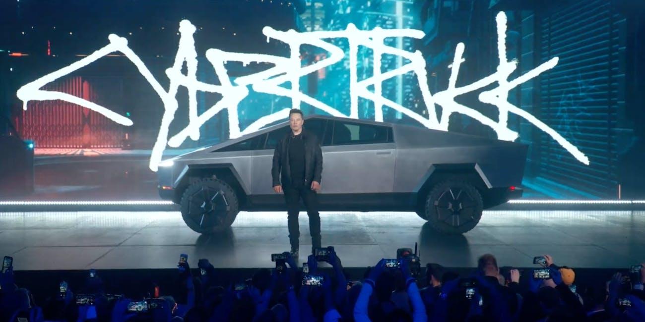 Tesla Cybertruck next to Elon Musk.
