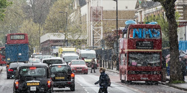 LONDON, ENGLAND - APRIL 26:  A private hire open top bus with NHS balloons stops by King's College Hospital as junior doctors strike in the snow on April 26, 2016 in London, England.  Junior doctors will walk out from 8am to 10pm on Tuesday and Wednesday this week. They will stop providing emergency care for the first time in the ongoing dispute with the Government over the forced imposition of new contracts.  Medical Leaders have called on the Prime Minister to intervene in the dispute to bring both sides back to the negotiating table.  (Photo by Chris Ratcliffe/Getty Images)
