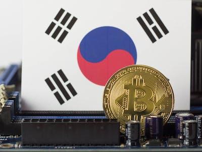 Golden bitcoin and South Korea flag