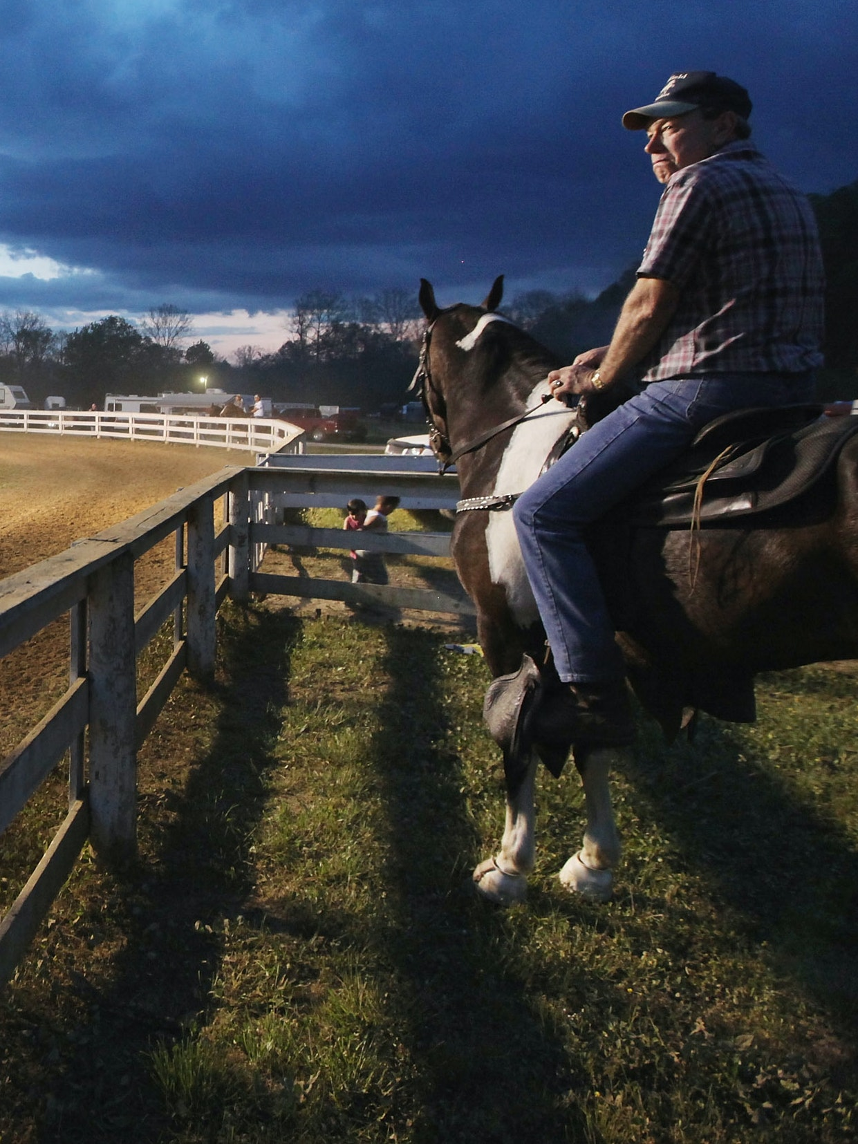 Horse riders gather at dusk at the Owsley County Saddle Club in Booneville, Kentucky.