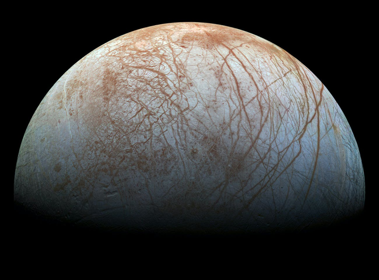 The puzzling, fascinating surface of Jupiter's icy moon Europa looms large in this newly-reprocessed color view, made from images taken by NASA's Galileo spacecraft in the late 1990s.