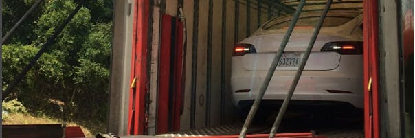 Nifty Photos Show the Tesla Model 3 on the way to testing.