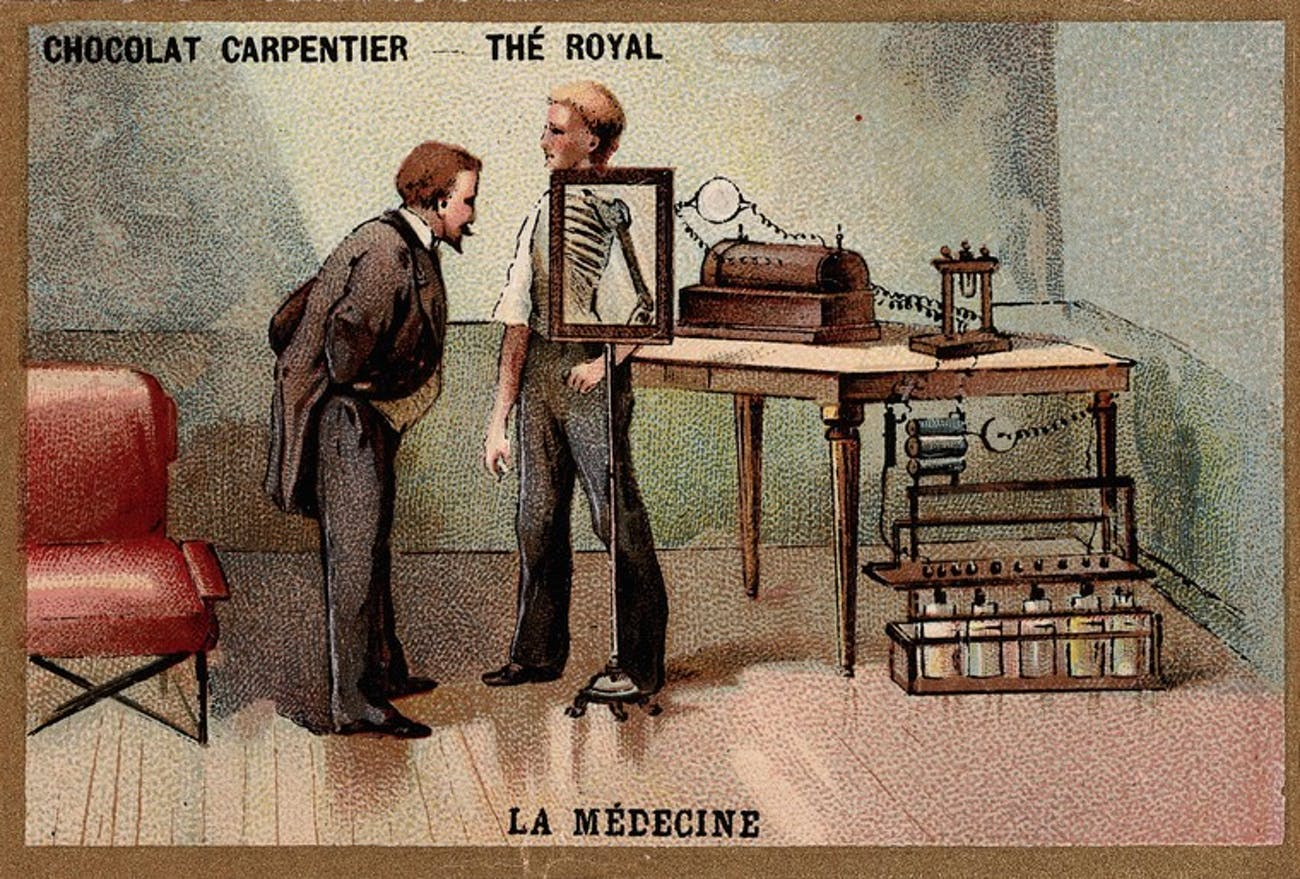 Wilhelm Conrad Roentgen looking into an x-ray.
