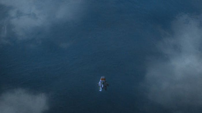 The shot in question: Ezra flies over the surface of a watery Tatooine.