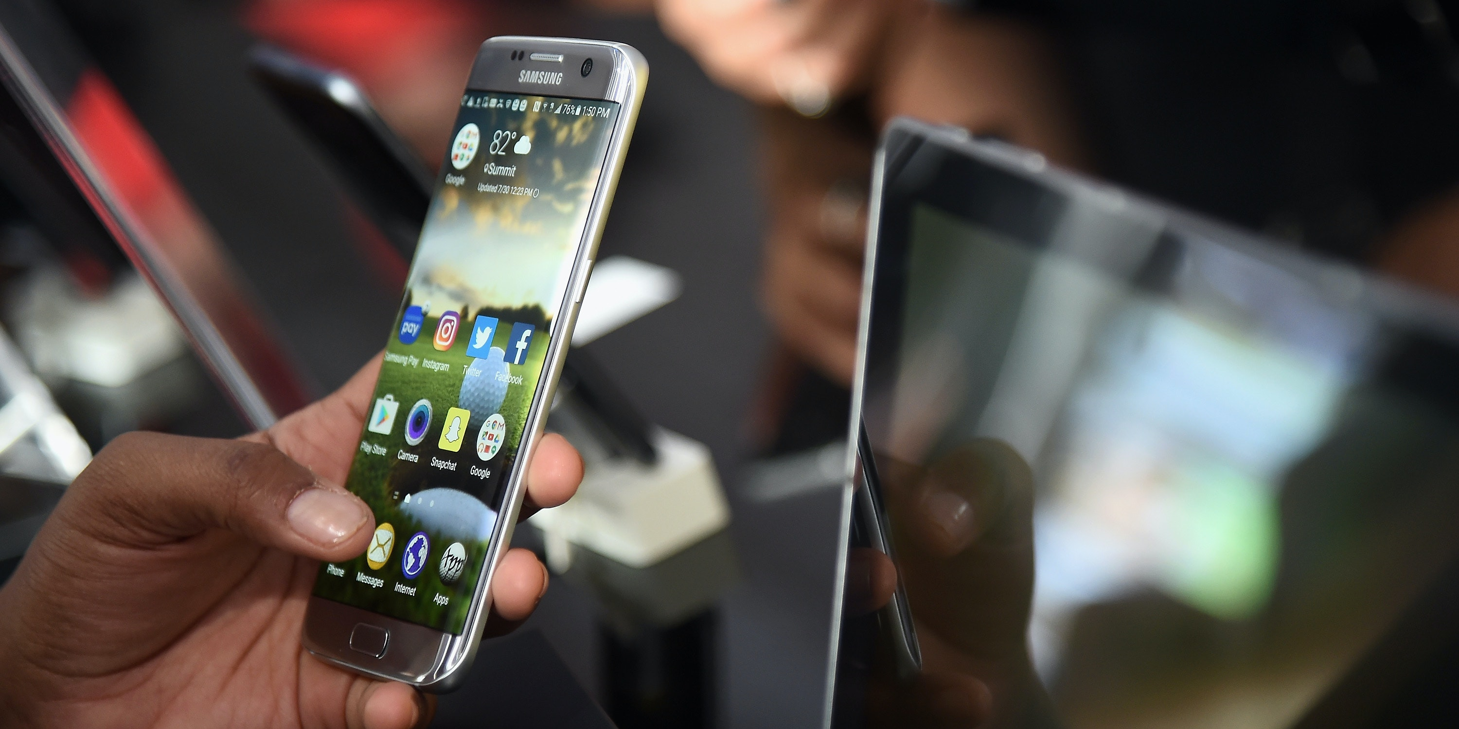 SPRINGFIELD, NJ - JULY 30:  A consumer enjoy the Samsung Galaxy S7 Edge smart phone at The Samsung Experience at the PGA Championship 2016 at Baltusrol Golf Club on July 30, 2016 in Springfield, New Jersey.  (Photo by Ilya S. Savenok/Getty Images for Samsung)
