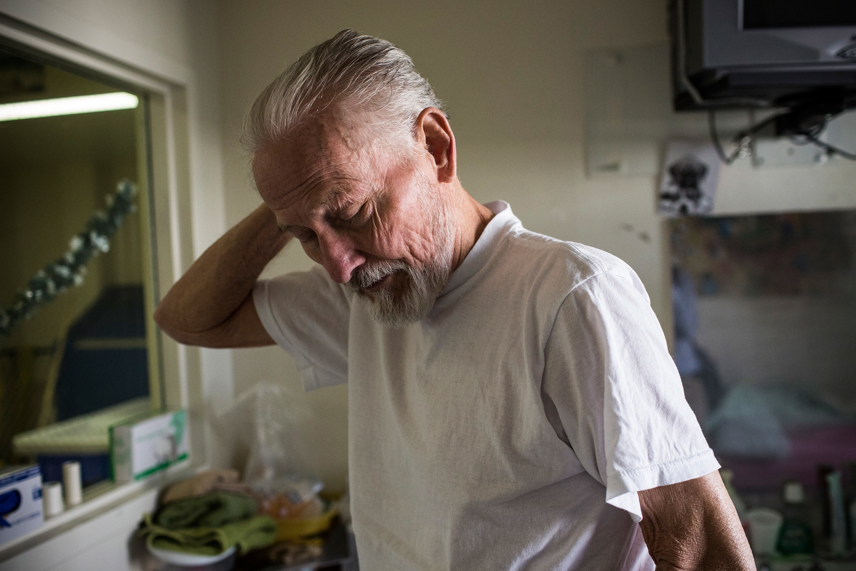 A 73-year-old hospice care patient diagnosed with terminal colon cancer, brushes his hair in the hospice care wing of California Medical Facility (CMF) on December 17, 2013 in Vacaville, California.