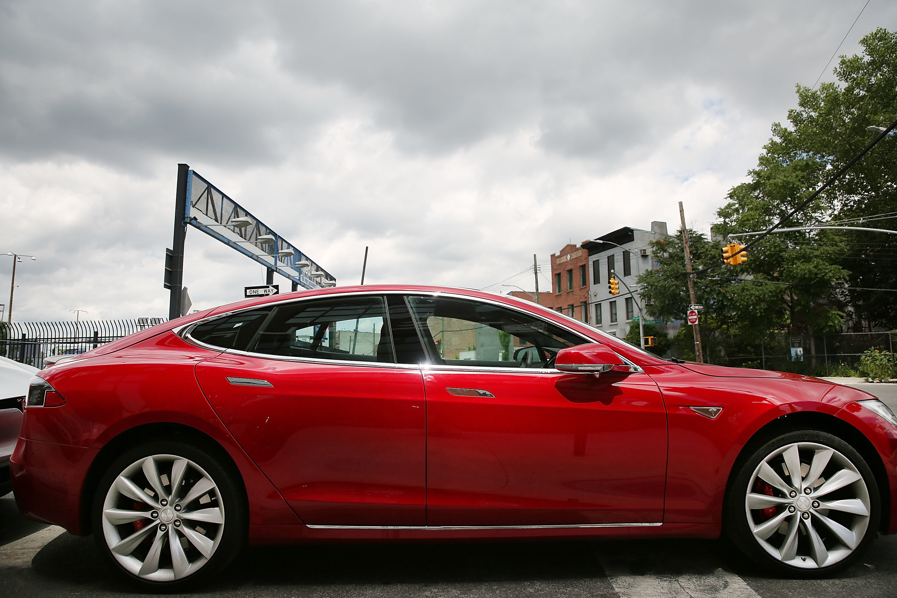 A Tesla model S sits parked outside of a new Tesla showroom and service center in Red Hook, Brooklyn. Teslas are wired with AT&T-backed connectivity in 2013.