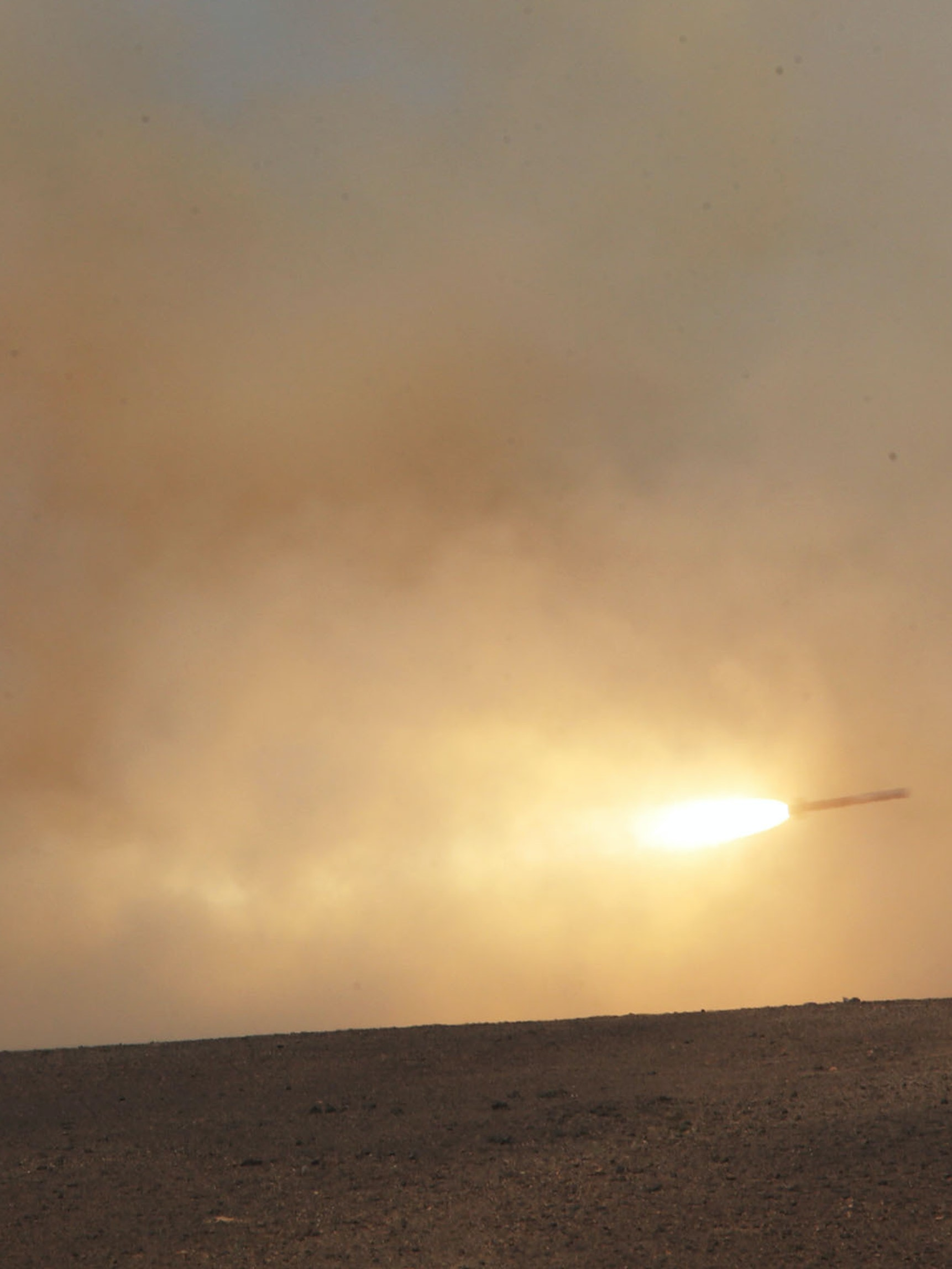 A missle is launched during joint Jordanian exercises with 18 nations including the U.S. in a final counter attack at the 5th annual exercise Eager Lion May 18, 2015 in the southeast desert of Wadi Shadiyah, Jordan. In the final exercise, two U.S. B-52 Stratofortress aircraft flew a 35-hour mission from the U.S. to Jordan directly and back. Also used in the exercises were Jordanian F-16 fighting falcons, high-mobility artillery rocket system (HIMARS), four Royal Jordanian air force AH-1 Cobras helicopters, three U.S. AH-64 Apaches helicopters, tanks, anti-tank guided missiles and heavy machine guns. (Photo by Jordan Pix/ Getty Images)