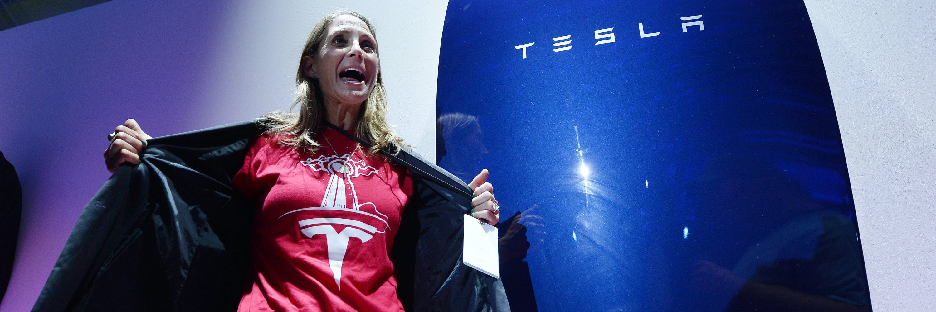 LOS ANGELES, CA - APRIL 30:  Guests pose with the Powerwall unit after Elon Musk, CEO of Tesla unveiled suit of batteries for homes, businesses, and utilities at Tesla Design Studio April 30, 2015 in Hawthorne, California. Musk unveiled the home battery named Powerwall with a selling price of $3500 for 10kWh and $3000 for 7kWh and very large utility pack called Powerpack. (Photo by Kevork Djansezian/Getty Images)